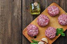 Raw meatballs on a chopping board