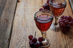 Glass of red wine and grape.