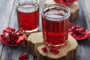 Glasses of red pomegranate juice