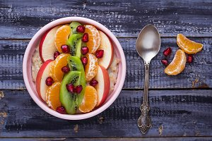 Bowl of oatmeal with fruits.