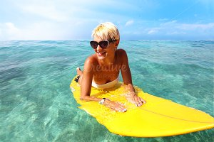 happy young women with surfboard