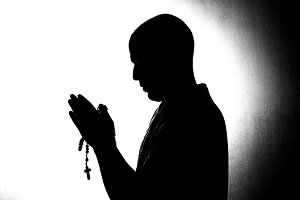 man hands in prayer.