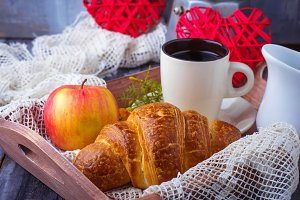 Croissant, coffee and heart