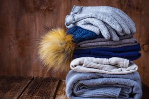 Stack of warm knitted clothes