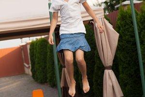 Girl is jumping on batut