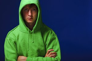 young man in green sweatshirt