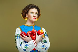 Young girl with apples