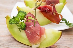 Concept of spanish food with melon and prosciutto