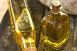 bottles of extra virgin olive oil on wooden background
