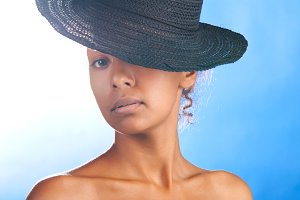 mulatto woman wearing black straw