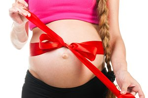 pregnant woman with red silk bow