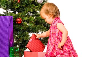 baby near christmas tree