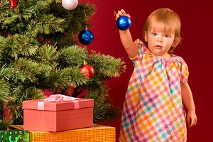 baby with christmas toy