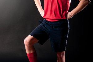 soccer player in dark