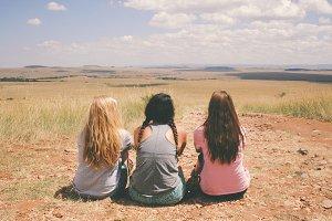 Three Girls Sitting in the Desert