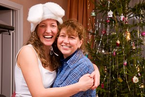 happy mom and daughter at home before christmas