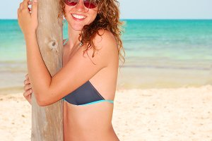 young beautiful smiling woman on a tropical beach