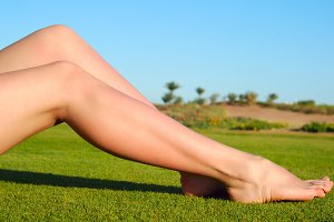 sexy femalelegs on the grass