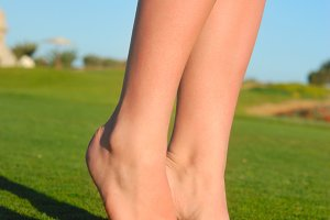 beautiful female legs on grass