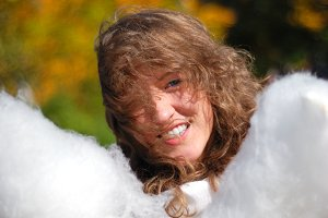 young fresh smiling woman with cotton candy in autumn