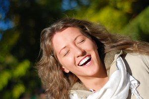 young fresh smiling woman in autumn