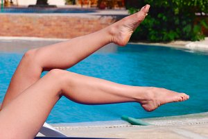 woman beautiful legs near the pool