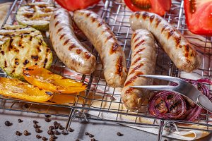 sausages on the grill grate