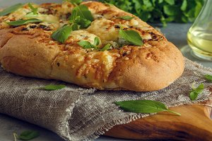 Focaccia with herbs and cheese