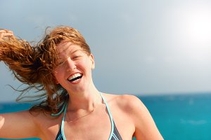 happy beautiful woman on sea