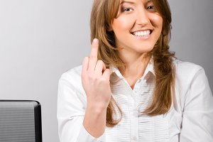 business woman is showing middle finger