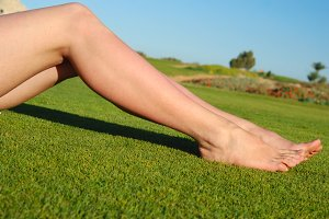 sexy female legs on the grass