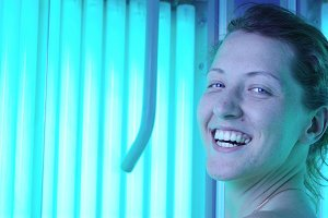 beautiful woman in vertical solarium