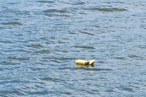 Floating life jacket in lake