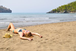 sexy woman is lying on the wild beach