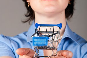 business woman is holding shopping cart