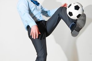 businessman is playing football