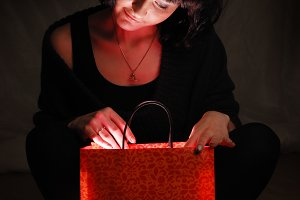 woman looks for a shining gift