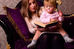 mother and her baby are reading