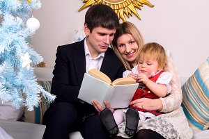 couple with baby are reading