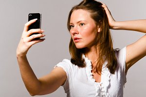 woman is taking picture of herself