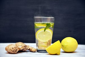 Ginger tea with lemon on a wooden background