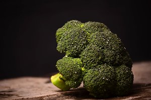 large green broccoli on a black background