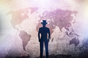 Man in hat and the world map.