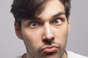 Man portrait cross squint skew eye