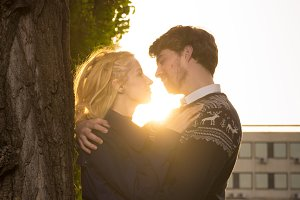 Boy girl couple hug sunlight.