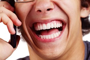 Laughing guy with cell phone
