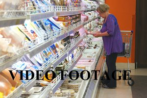 Old woman buying dairy
