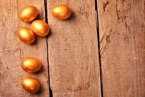 golden eggs on wooden background. investment concept