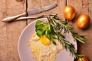 omelet of Golden eggs for Breakfast on wooden background