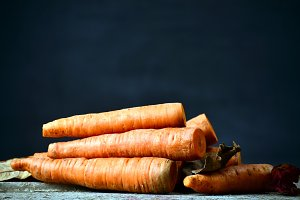 Fresh Organic Carrots on wooden background